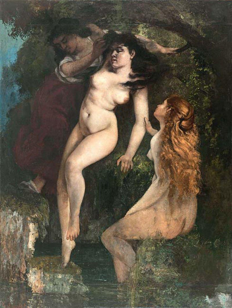 """Gustave Courbet: """"Les trois baigneuses"""", 1865–68, Öl auf Papier auf Leinwand, 126,5 × 95 cm: Zwei Gefährtinnen stützen die junge Nackte in der Bildmitte, die sich mit geschlossenen Augen ins Wasser tastet. Während das Licht frontal auf ihren Körper fällt, liegt ihr verträumt-sinnliches Gesicht im Schatten. Courbet inszenierte den für seine Zeit sehr naturalistischen weiblichen Akt in einem poetischen Zusammenspiel mit Vegetation und Quelle."""