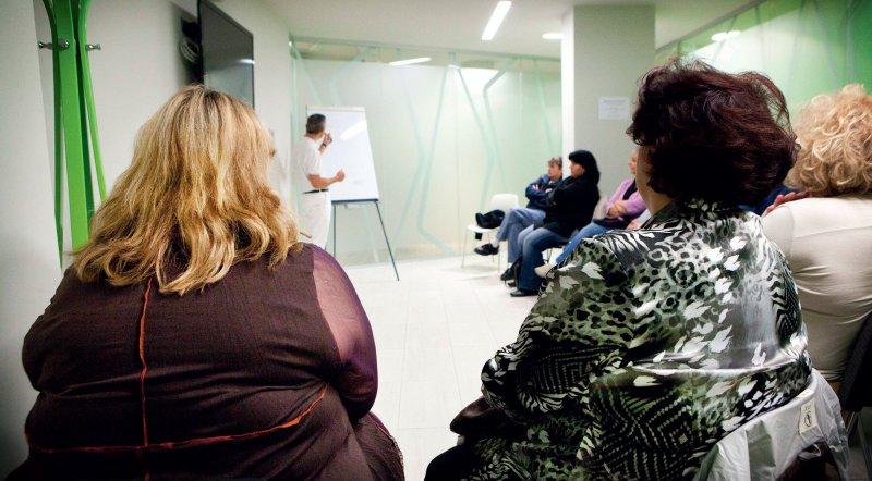 Teilnehmer bei einer Informationsveranstaltung zum Thema Adipositaschirurgie. Foto: picture alliance